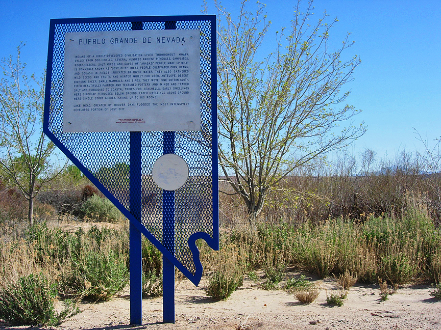 About four miles directly behind this marker lies the exact site of The Lost City, one of North America earliest civilizations.  Remnants of the city are submerged beneath the waters of Lake Mead
