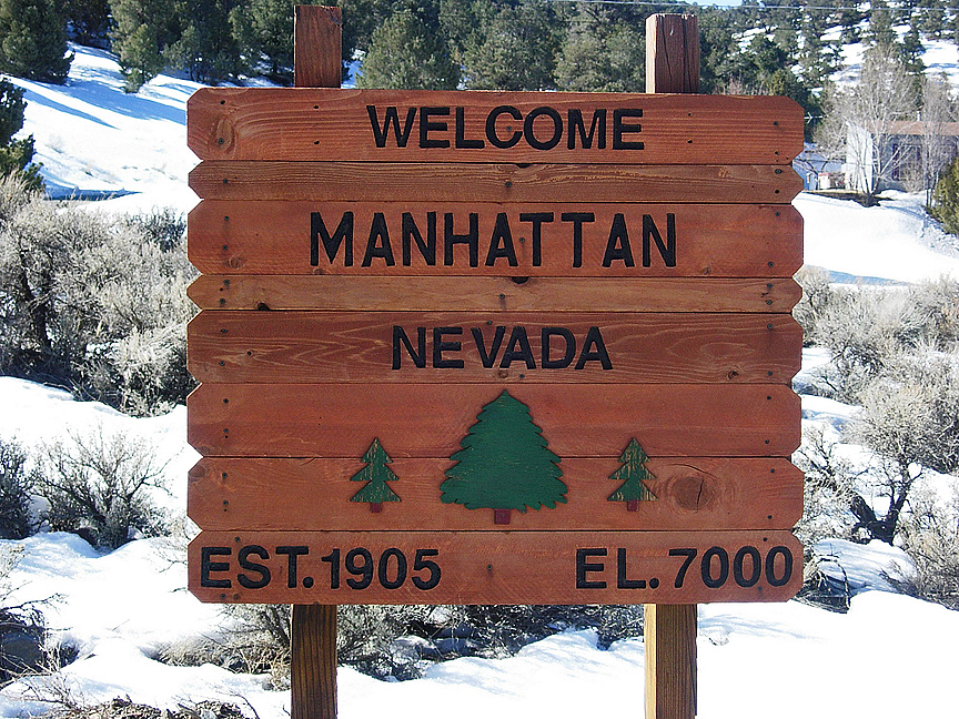 Welcome to Manhattan, Nevada.  Find this sign at the entrance to town, 5 miles to the east